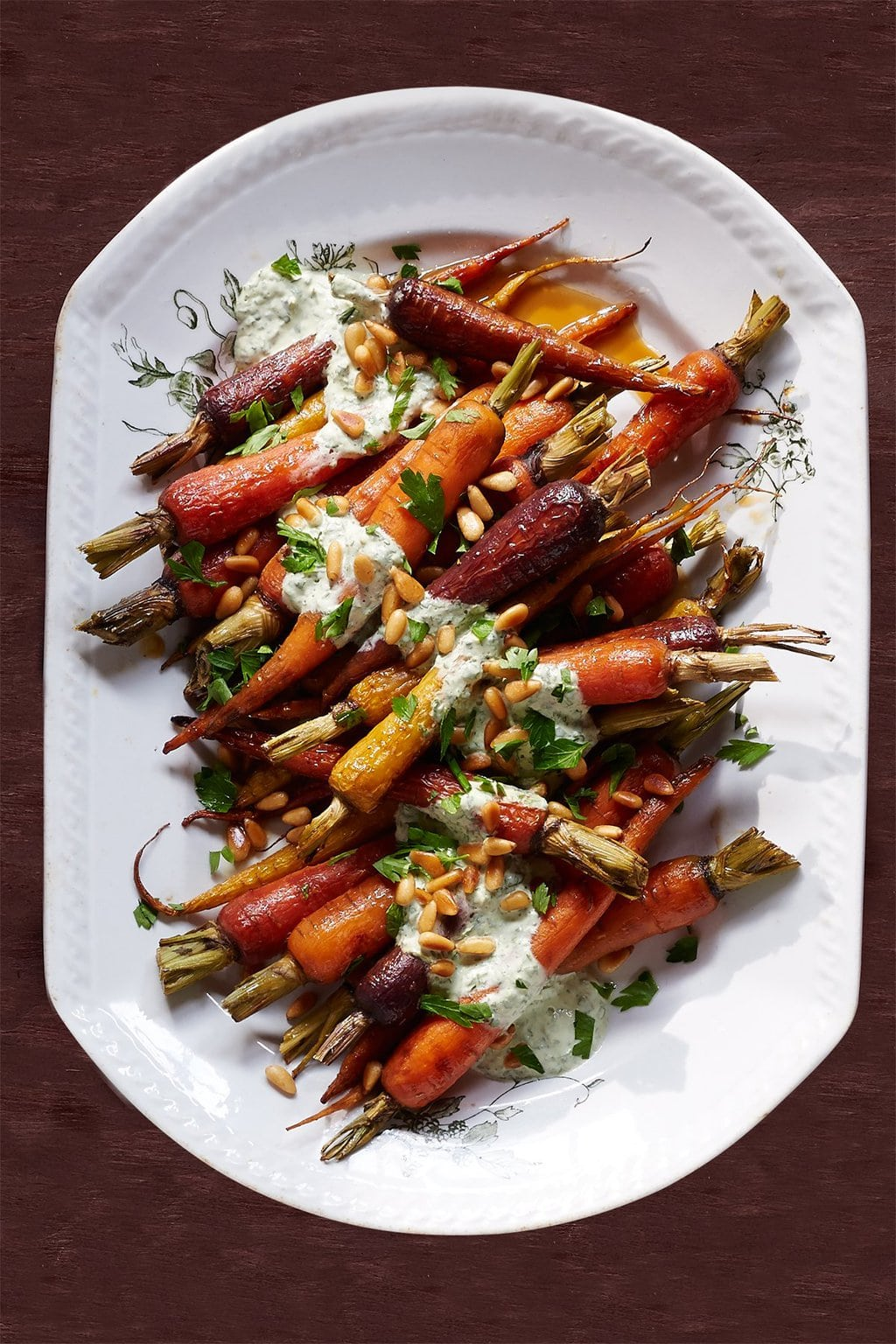 "Overhead photo of Orange Carrots with Yogurt Parsley Dressing from ""19 Delicious Thanksgiving Sides"" blog post."